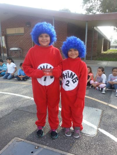 Children in costumes as thing one thing two