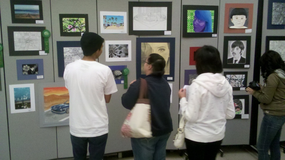 Visitors looking at Art Show artwork
